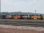Two loaded trains wait in the yard for their turn to go east