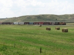 BNSF 4431 & 637 lead a general freight across the hay fields of eastern Wyoming