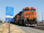 A loaded BNSF coal train sits in MRL territory