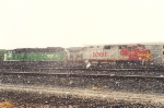 Westbound manifest waits in yard as the snow falls