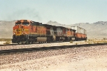 Westbound stack train continues climb uphill
