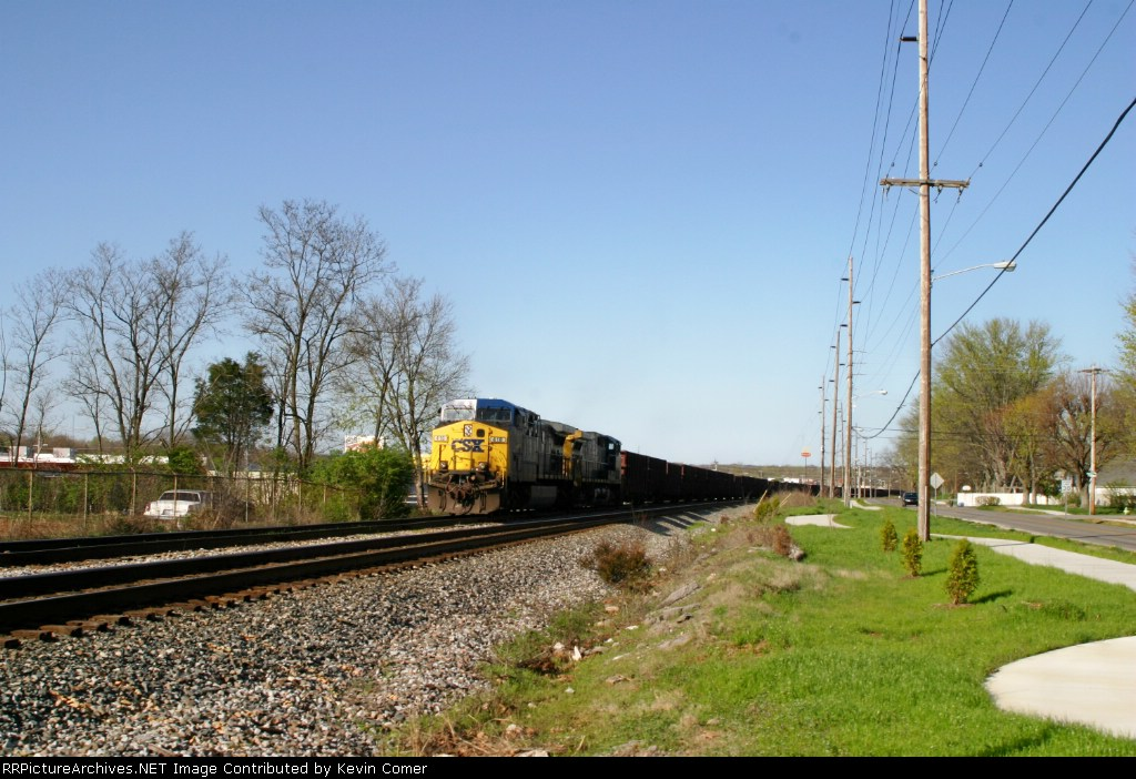 WO82 with 55 ballast loads waits on the Morgantown siding along Creason Drive for the clear to head south 4/1/09