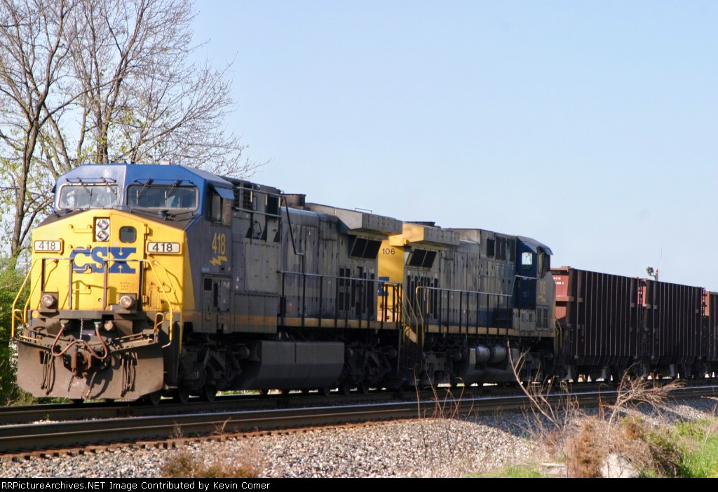 CSX WO82 sits on the Morgantown siding between Robinson Lane and Emmitt Drive with 55 loaded ballast cars 4/1/09