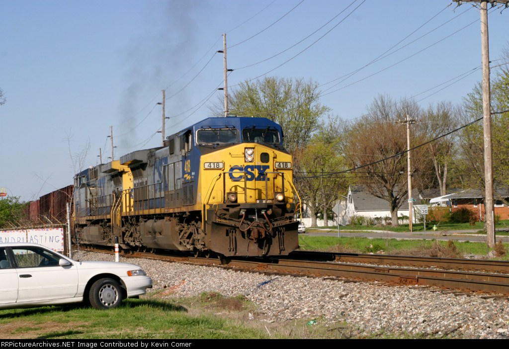 WO82 approaches Emmitt Drive on the Morgantown siding with 55 loaded ballast cars 4/1/09