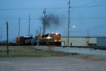 CSX 4802/CSX 7594 belch smoke as they arrive at Memphis Jct. Yard at dusk 3/7/09 leading Q275-07