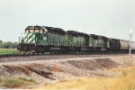 Westbound grain train with classic power