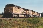 Westbound grain train rounds curve