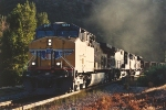 Eastbound coal train out of shadows