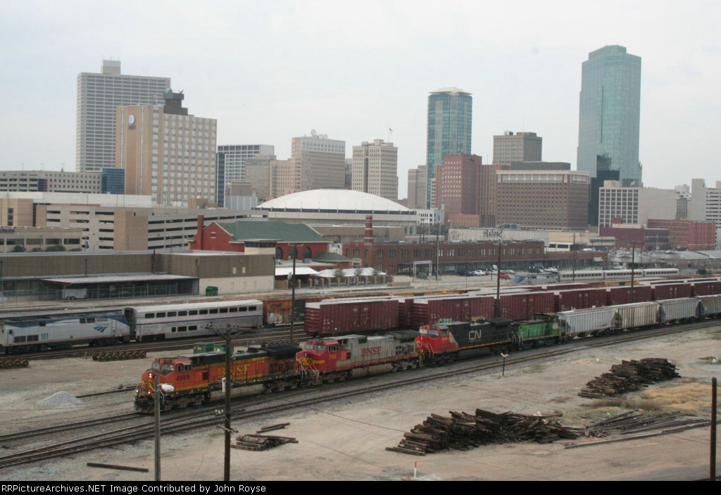 BNSF 4989 leads a grain train towards Tower 55.  This photo was taken from a bridge