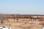BNSF 5528 leads a stack train over the Red River ATSF Bridge