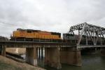 UP_4354 and TFM_1652 depart Davidson Yard crossing the Trinity Rever Bridge