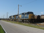 CSX 4677 and 4694 sitting adjacent to a long string of molten sulfer tank cars in the yard