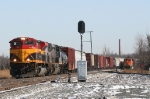KCS 4033 brings its manifest train south down the main as a BNSF TXUX empty gets ready to depart