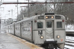 local train for Trenton with MU Arrows arrives a bit late because of weather related delays