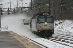 Amtrak AEM-7 # 929 kicks up the snow flying  down the main dor DC