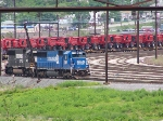 NS 5410 and sister unit parked in the south end of the yard with lots of farm equipment.