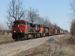 Two CN Dash-9's lead BNSF 8874 west with M395