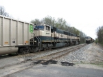 E949-28 rolls west as D801/N903 waits in the siding