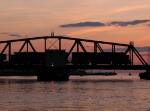 Just after sunset, two BNSF SD70MAC's lead N903-02 across the swing bridge
