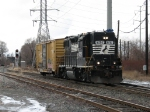 LD12 rolls through the junction with one boxcar