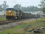 Loaded coal train passes through town