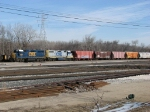CSX 2567 & 2519 sit with a cut of salt hoppers