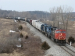 Units in CN, Conrail and CSX YN3 paint head east with Q326-05