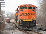 BNSF 9399 leans as it rolls through the crossover with N954-17