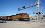 BNSF 4836 is stopped in the street waiting for the switch just ahead to be thrown
