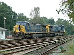 CSX 212 and 501 wait for a coal train to arrive to push