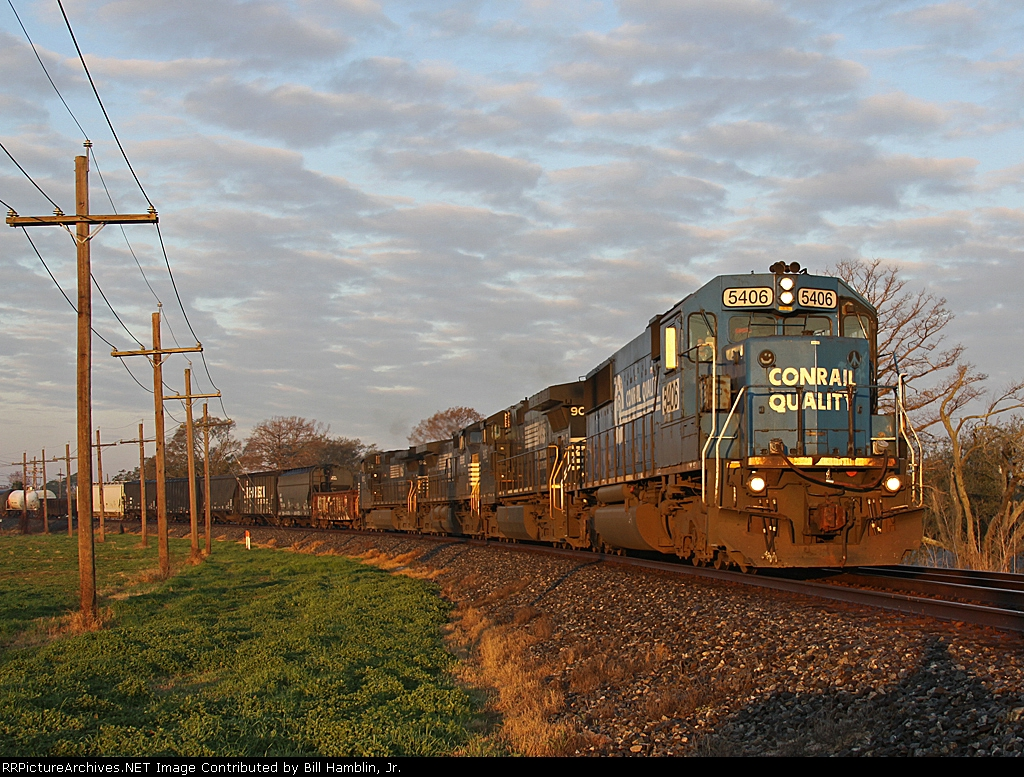 """NS 5406 (Former Conrail) displays some interesting """"nose art"""" as it rounds the bend."""