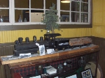 A model of Tionesta Valley number 2 and a log car near the ticket window