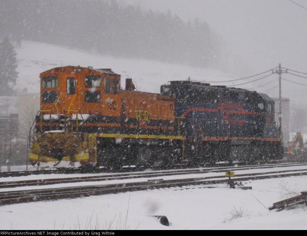 BPRR 1512 and 302 idle near the Johnsonburg yard in a heavy snowstorm