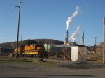 BPRR 886 sits near the Johnsonburg Yard with the Domtar paper mill stacks in the background