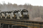 NS 7105 leads three more thundering horses across trestle