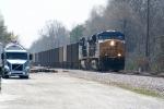 CSX U170 North passing plastic pellet truck