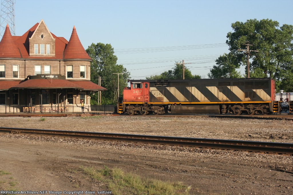 A pair of CN GE 6 axles lead a mixed freight Eastbound in Fron of Durand Station.