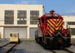 Locomotive and speeder sit outside Gray Rail Shop
