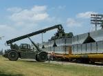 A Kalmar removes the load