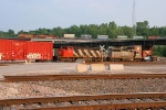 CN 6914 at Santa Fe. Jct. as BNSF 4532 passes above