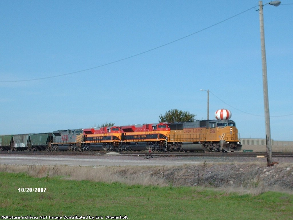 KCS grain train Boone with two southern bells.