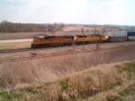 UP SD70Ms 4867 & 5037 flying east with stacker.