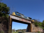 CSX 7687 crossing an old ACL RR trestle over NS trackage