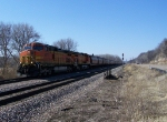 A Pair of Dash-9Ws Lead Grain Hoppers East on the Aurora Sub