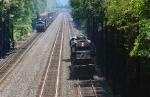 Westbound helpers meet an eastbound stack train