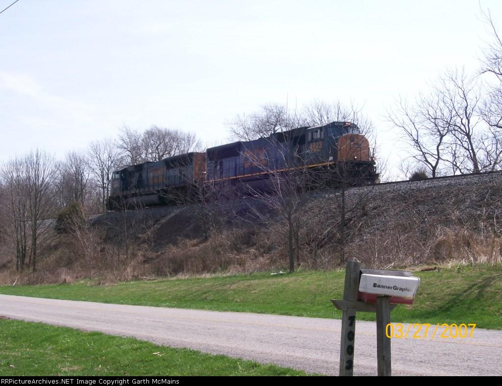 CSX 4823 leads a lite move west.