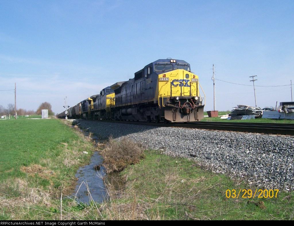 CSX 7341 leads a CSXT Grain Express through Calcutta