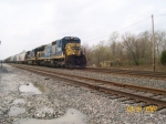 A rusty CSX 7564 leads a mix east