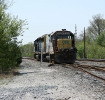 J721 backs into the siding to pick up the 3 cars