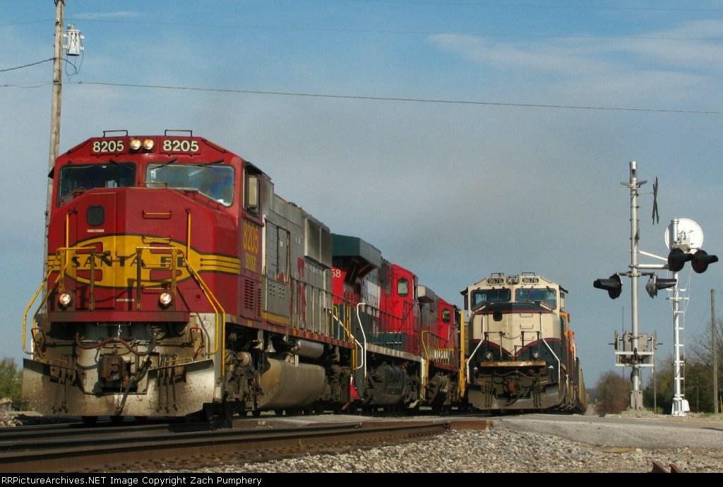 Northbound BNSF Merchandise Train Passing a Tied Down Northbound BNSF Empty Coal Train